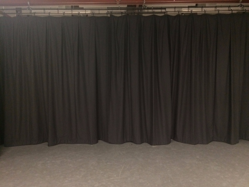Before & After - Mascalls Academy - After - new stage curtains creating a clear workspace
