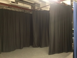 After - new stage curtains to create a creative workspace