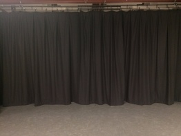 After - new stage curtains creating a clear workspace